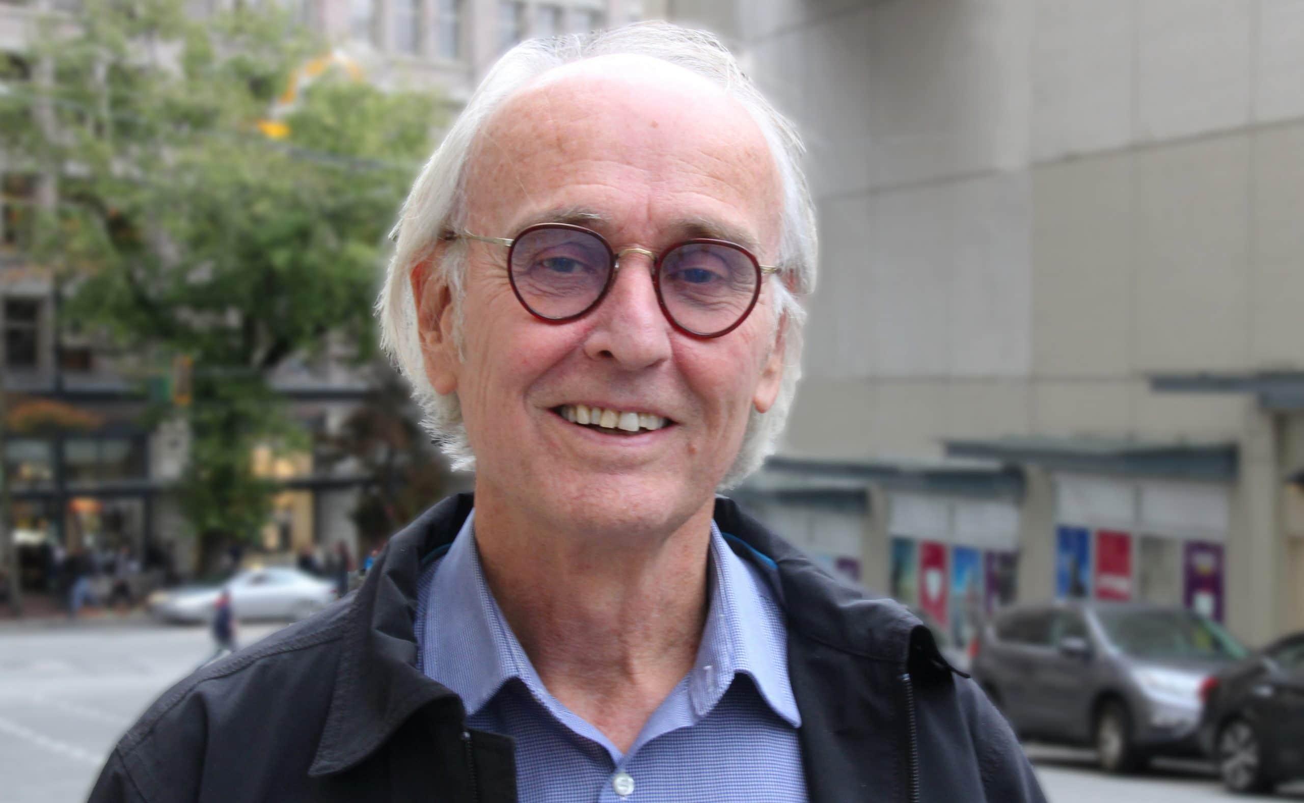 Man smiles on Vancouver street near Gastown