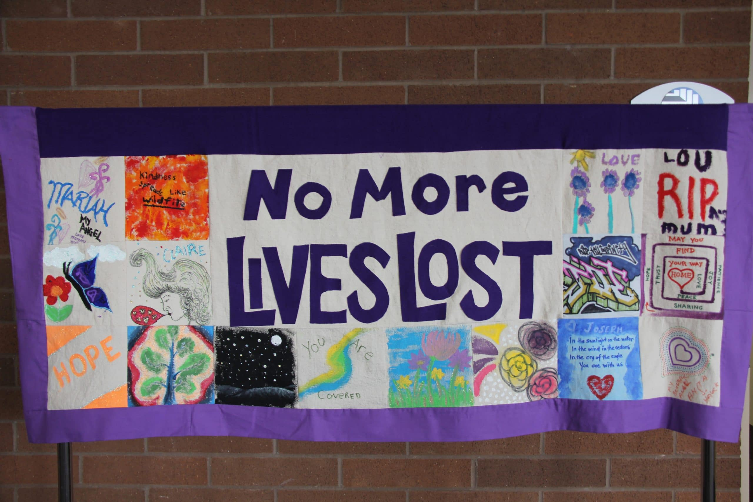 """Quilted banner reading """"no more lives lost"""""""