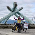 Iliajah Pidskalny in front of the Olympic Flame in Vancouver | Iliajah Pidskalny cycle